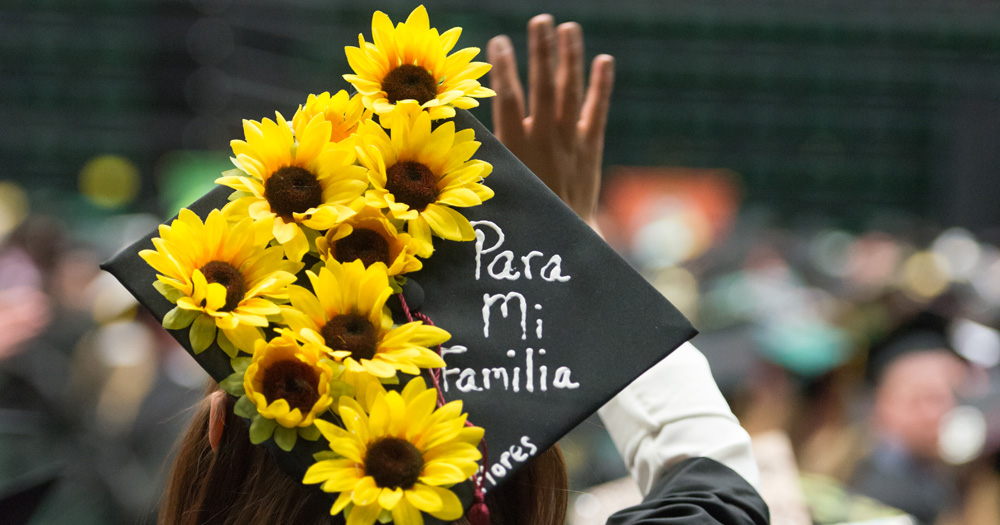 Photo of CSU graduate waving during commencement