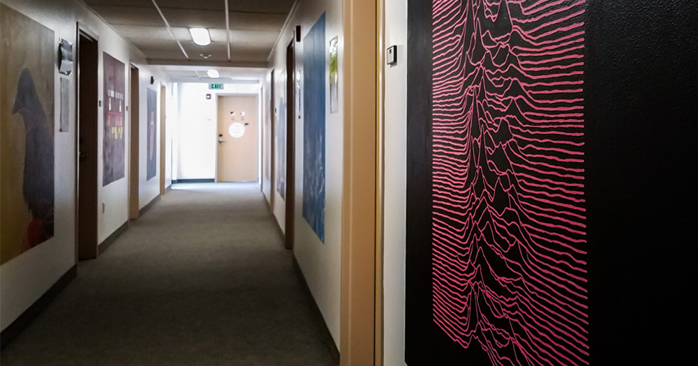 Each floor of the building is filled with a particular theme of student artwork - this floor's theme is famous album covers.