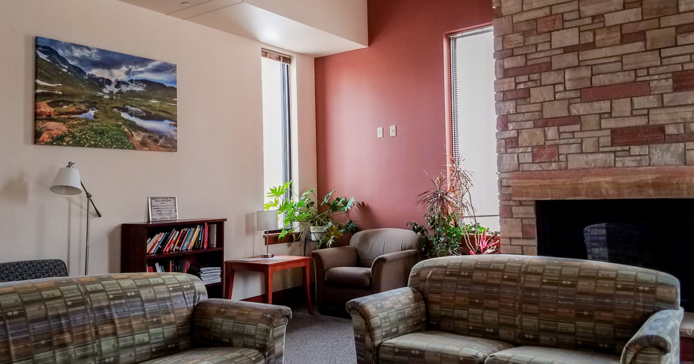 A community area fit with a fireplace is available on the first floor of the hall.
