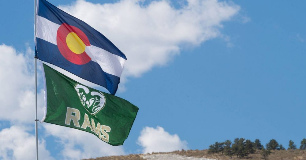 The State of Colorado and CSU flags flying high.