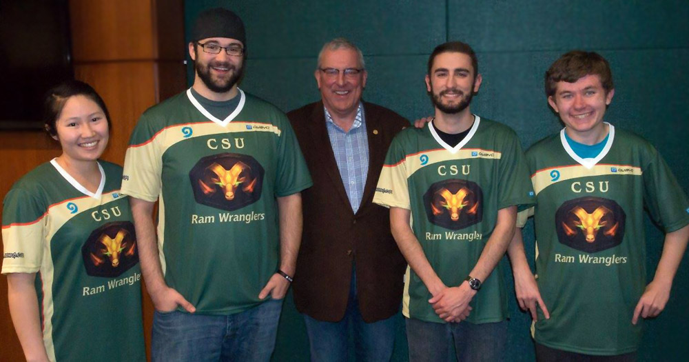 Kyle's Hearthstone team, the Ram Wranglers, pose for a photo with Fort Collins Mayor Wade Troxell.