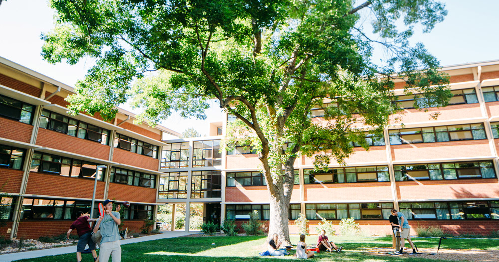 Students relax outside of their residence halls on the CSU campus.