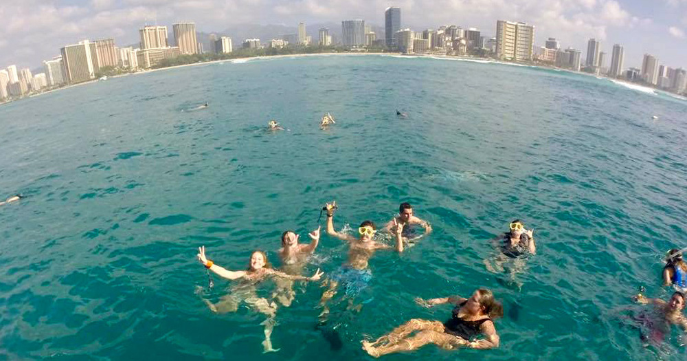 Rachel and other SAS participants take a dip in the ocean while ported in Hawaii.