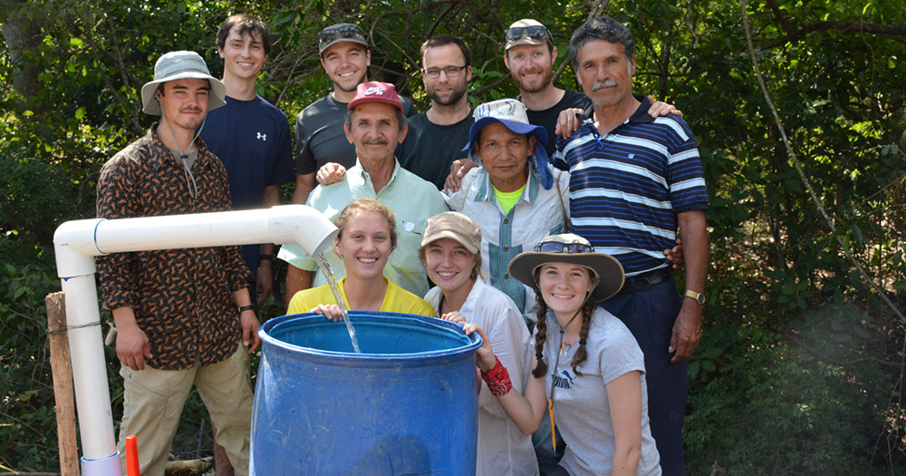 The CSU chapter of Engineers Without Borders, pictured here with residents of La Criba, Salvador, installed water flow systems in the area.