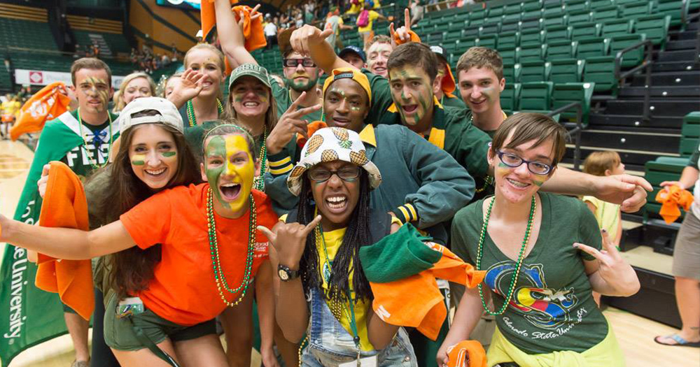 Nikki, second on the left - bottom row, shows off her school pride sporting dual-colored complete face paint.