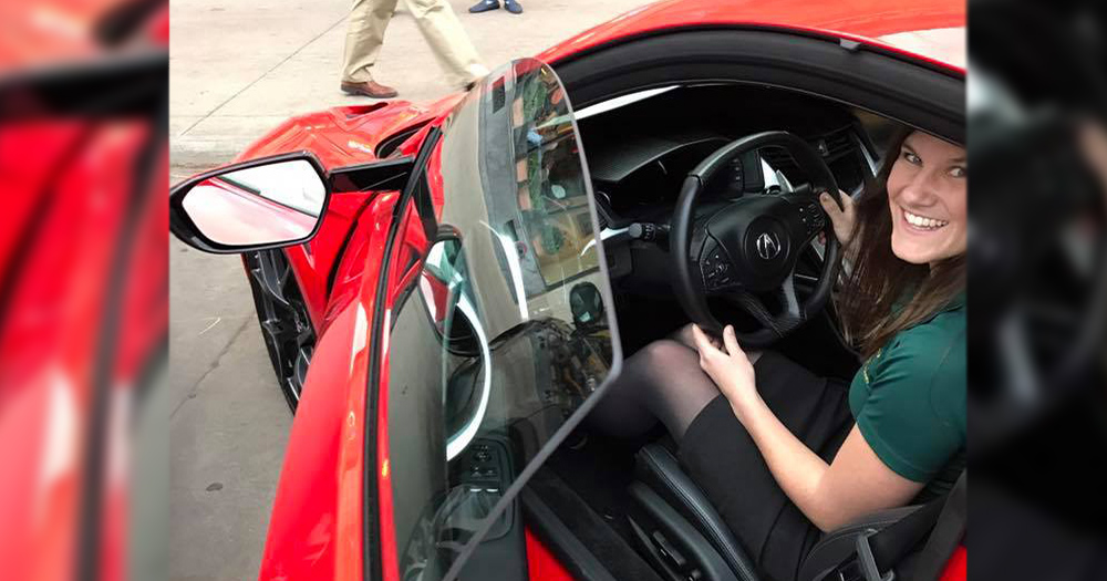 Nikki turns on an Acura NSX at an engineering event after meeting with Honda research and development.