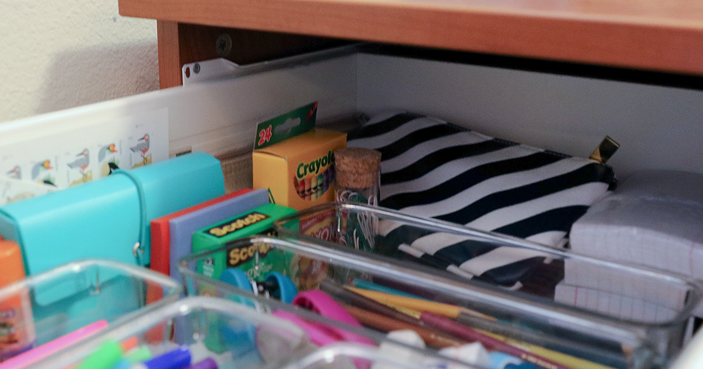 Buy plastic containers to organize your office supplies.