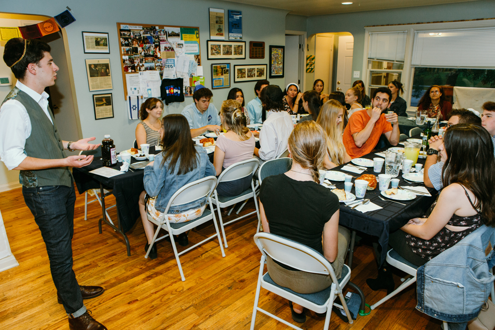 Students gather in the Hillel House for a weekly Shabbat dinner.