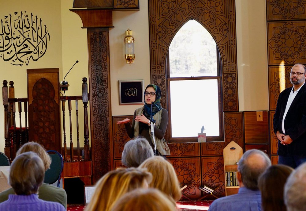 Current CSU student Hadeel speaks during a community event at the Islamic Center. Pictured to the right is Islamic Center President Tawfik AboEllail.