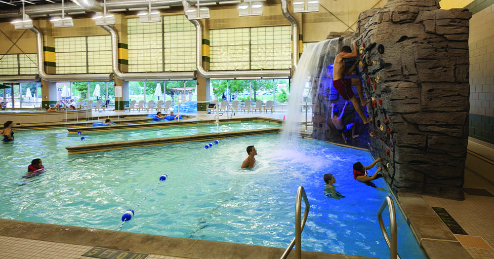 The waterfall and climbing wall in the pool area.