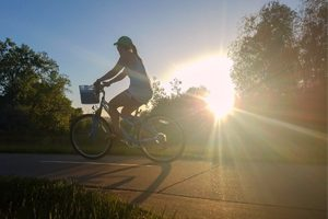 A biker rides on the Spring Creek trail.