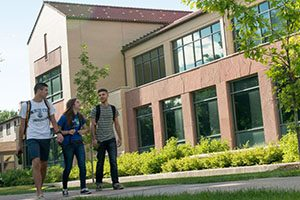 New students walking outside a CSU academic building.