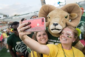 Students take a photo with CAM the Ram.