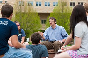 Teacher lecturing to CSU students outside