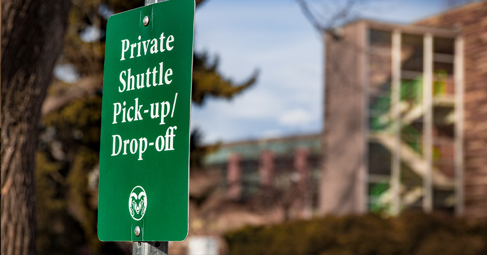 A private shuttle stop near Allison Hall on campus.