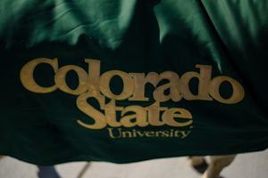 CAM the Ram stands with his CSU cloak.