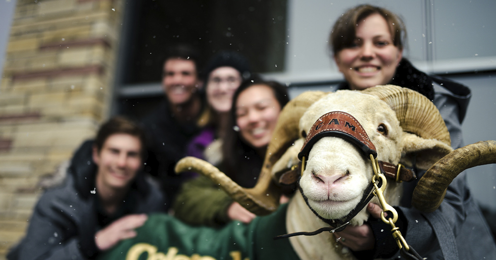 A group of students pose with CAM the Ram.