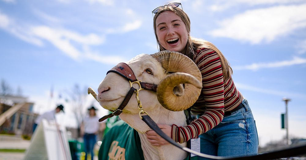 Student smiling with CAM the Ram