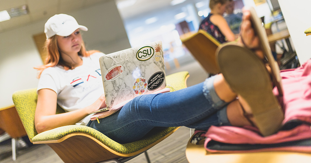 Student with her feet up while working on laptop