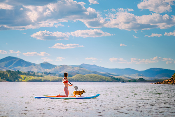 Woman and dog on paddleboard at Horsetooth Reservoir