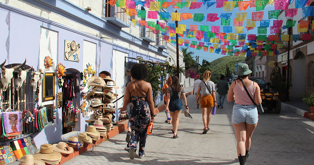 people walking through a street in mexico