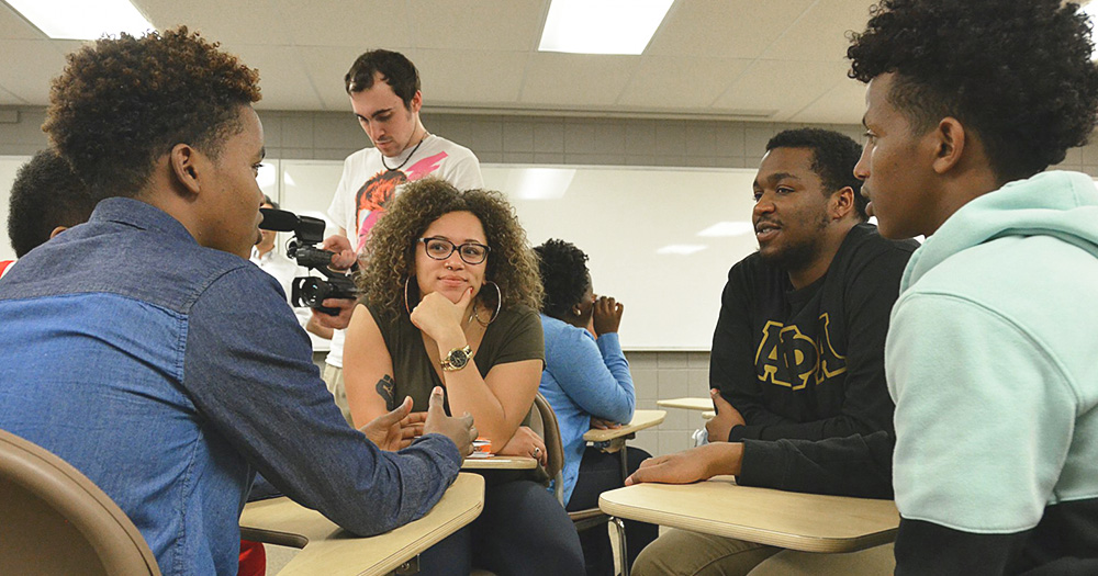 Students have a lively discussion in an ethnic studies class