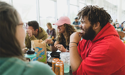 Students laugh and talk during lunch