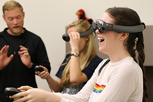 students experience virtual reality goggles