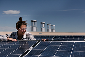 an engineering student works on solar power panels